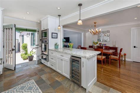 Kitchen With Both Peninsula And Island by Kitchen Peninsula With Ovens And Wine Cooler Kitchen