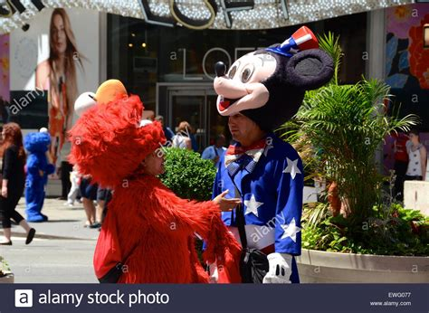 mickey mouse elmo costumes times square  york stock