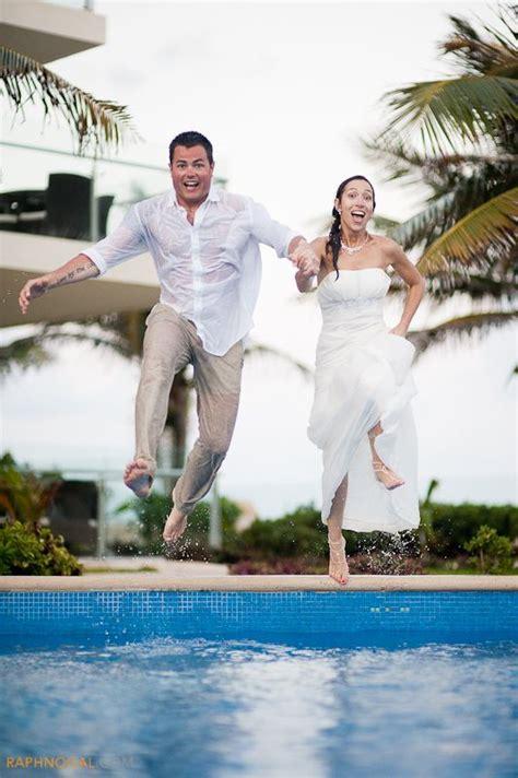 bride  groom jumping  pool