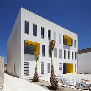Modern Health Center Building in White and Yellow