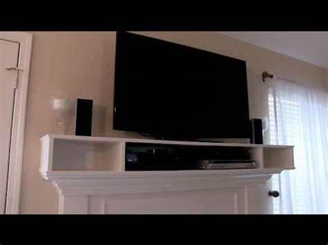 tv above fireplace where to put components mantle cabinet for tv components how to