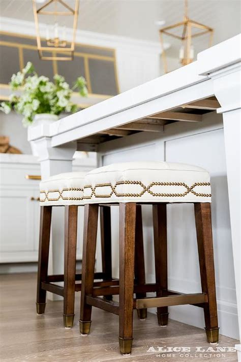 Kitchen Island With Backless Brass Nailhead Counter Stools