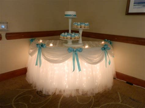 tulle and lights under cake table quincenera pinterest