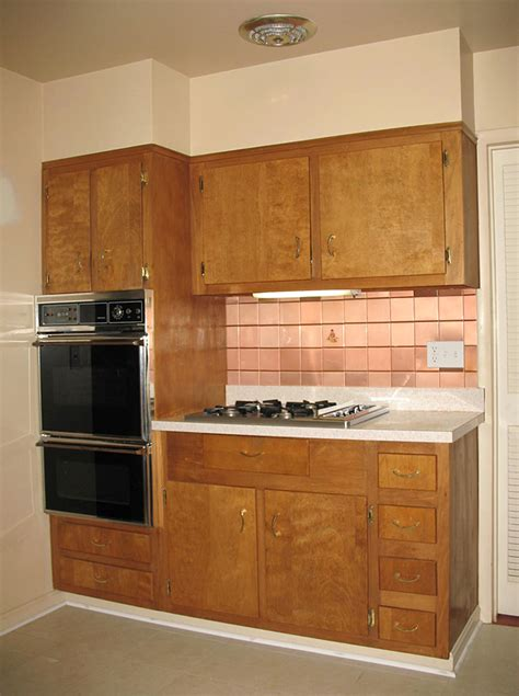 painting wood kitchen cabinets should nancy paint her vintage wood cabinets retro
