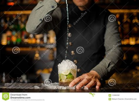 Barman Pouring Cachaca Into The Cocktail Glass Process