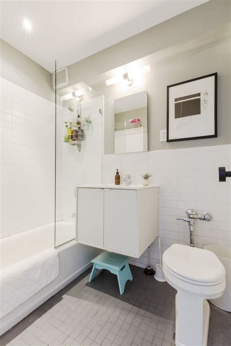 glass shower door turns small baths grand