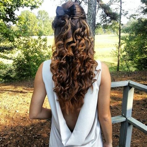 i did this for my friends bday out curly hair with a swisted bump fishtail braid