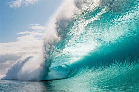 clark  swims  giant ocean waves  capture
