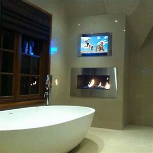 The block mirror tv block all stars mirror tv bathroom tv for Bathroom with fireplace and tv