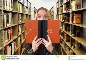 Woman Reading Book In Library Stock Photo - Image: 23071460