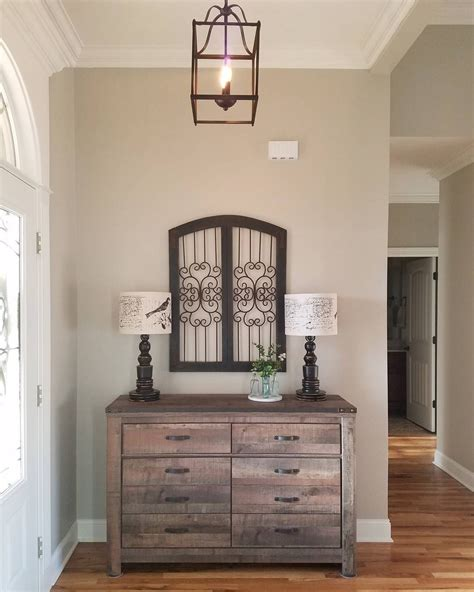 rustic and classic entryway decor neutral paint color is