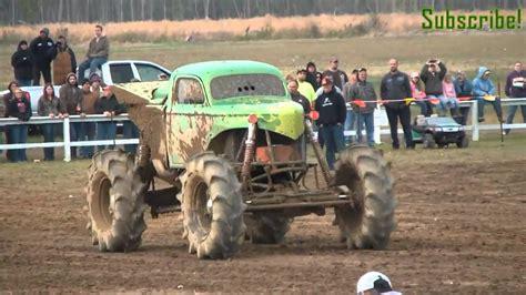 muddy monster truck videos king sling monster mud truck rolls huge air dennis