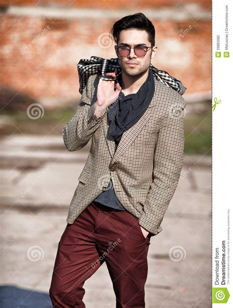 Fashion Man Model Dressed Elegant Holding A Bag Stock