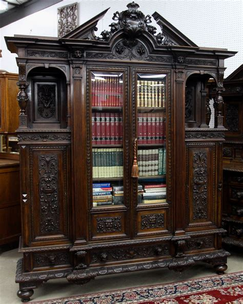 Cool Bookcases For Sale by Antique Four Door Carved Walnut Bookcase