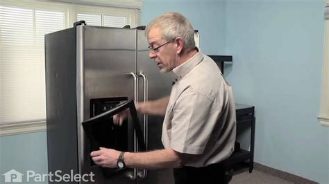 refrigerator repair replacing  ice dispenser door assembly flapper ge part wrx