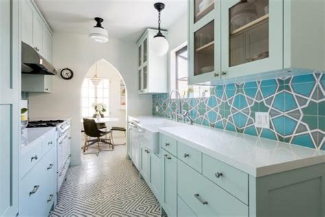 eclectic galley kitchen  mint blue cabinets hgtv