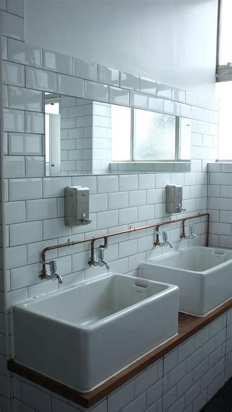white metro tiles  copper pipes shootfactory london
