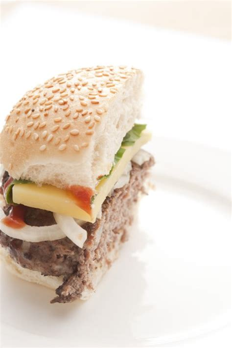 cut cheeseburger  stock image