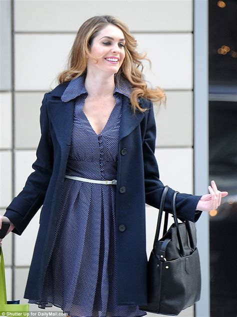 Hope Hicks is all smiles as she floats out of apartment ...