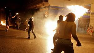Masked protesters clash with Greek police on anniversary ...