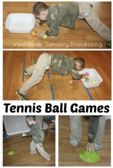 proprioceptive gross motor sensory play jumping lines activity 412 | Tennis Ball Games Vestibular Sensory processing Gross Motor Activities 201x300