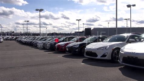 New Cars At Auto Dealership, In Parking Lot