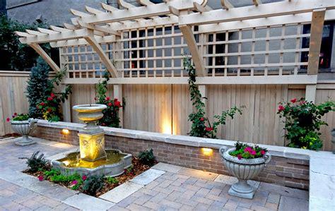 ornate wood trellis brick seat wall paver patio and