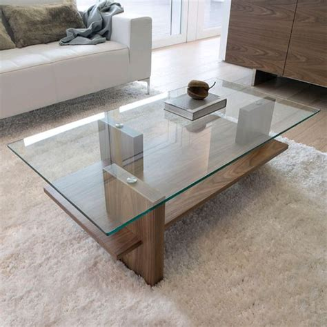 A beautiful design for a coffee table that combined wood, glass and stainless. 29 Chic Glass Coffee Tables That Catch An Eye - DigsDigs