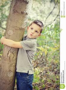 Boy Hugging Tree Stock Photo