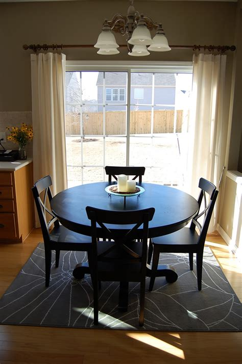 20 top gallery of oval how to place a rug with a round dining table
