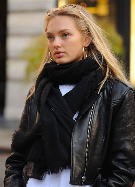 romee strijd wears black leather jacket tights