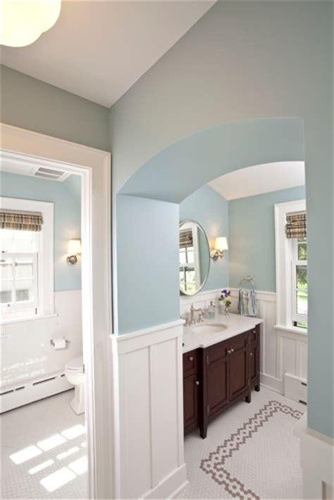 Traditional bathroom with dark wood vanity, white