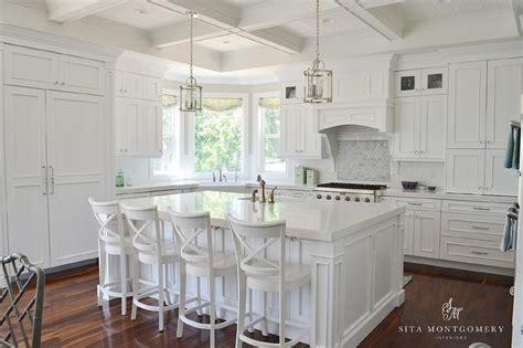 white kitchen island with stools white x back island stools transitional kitchen