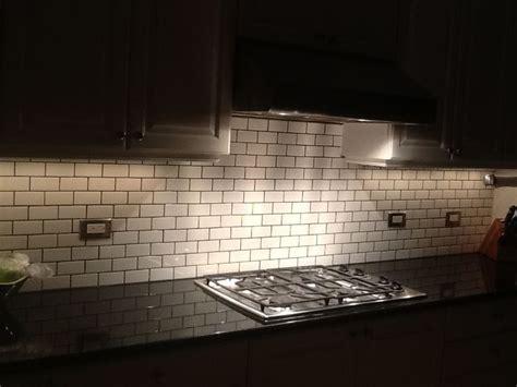 grouting tile backsplash in kitchen 2x4 white subway tile gray grout xenon 6971