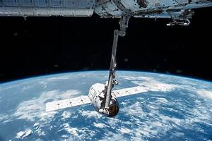 Canadarm2 Robotic Arm Grapples the SpaceX Dragon | NASA
