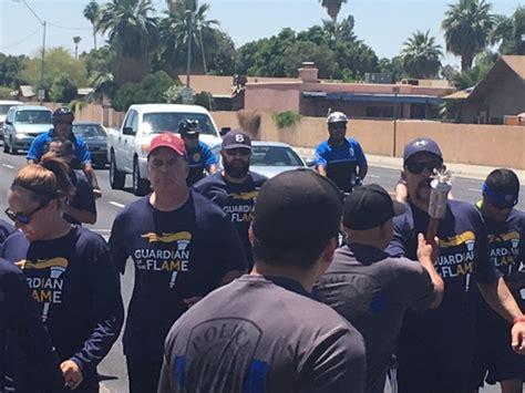 qpd participates   law enforcement torch run