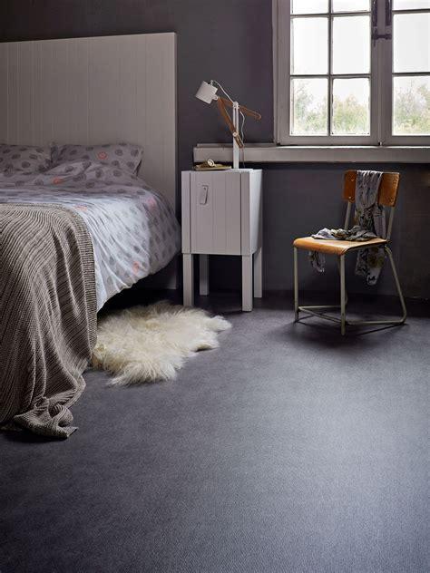 dark marmoleum floor   bedroom   white bed