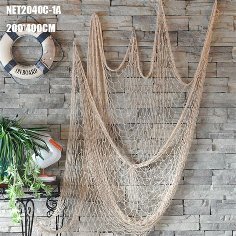 It is good decoration accessories for theme bars, party's cafe or restaurants. Decorative Shell Hanging Fish Net Nautical Ocean Theme Home Wall Decor Wall Stickers Decoration ...