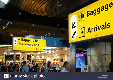 Schiphol Arrival by Baggage And Arrival Hall Sign Amsterdam Schiphol Airport
