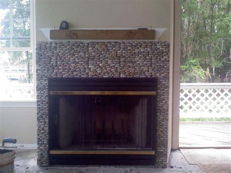 java tan standing pebble tile fireplaces pebble