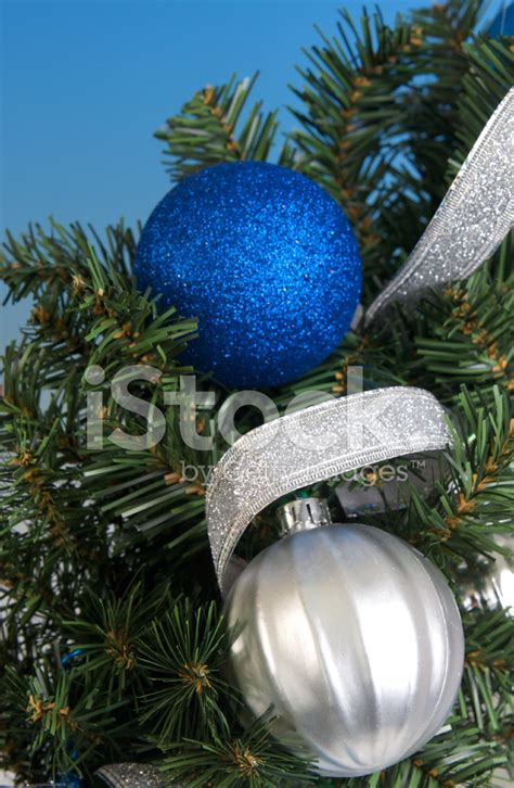 blue and silver christmas ornaments background stock