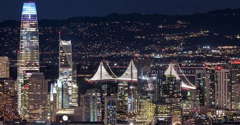 san francisco  night salesforce tower bay bridge