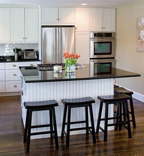 white kitchen with black island black white kitchen trending industrial luxe design