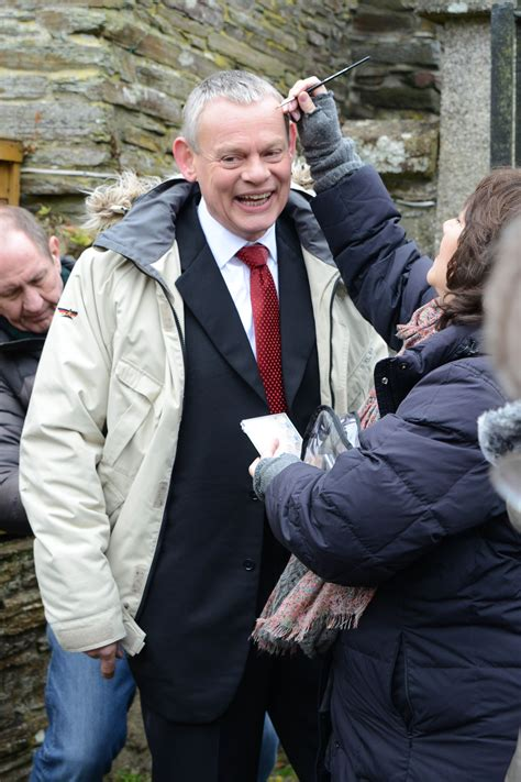 You know it's a behind-the-scenes shot when you see Doc Martin with a smile! Martin ...
