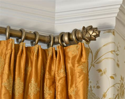 silk panels with brushed gold rod and rings traditional