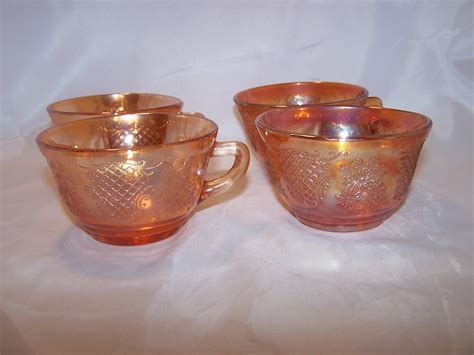 Marigold Carnival Glass Creamer and Cups, Flowers and