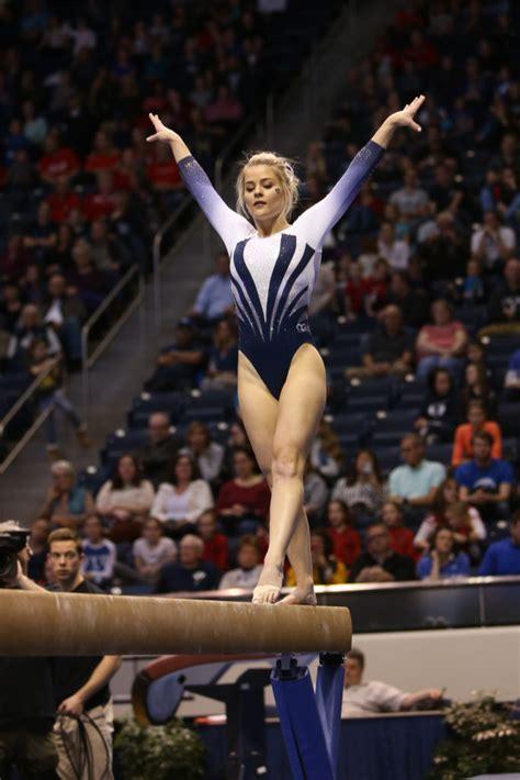 gymnastic team carries  seasons high note
