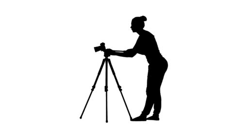12238 photographer tripod silhouette operator works with the on a tripod silhouette by
