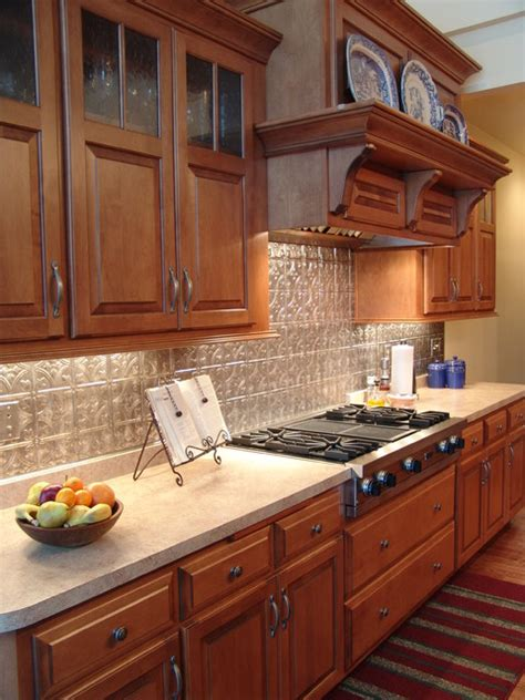 maple cabinets tin backsplash traditional kitchen 604 traditional kitchen