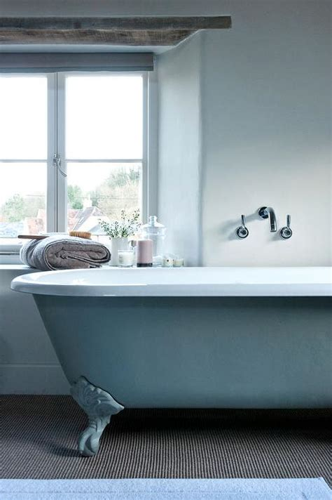 blue claw foot tub  wall mount tub filler cottage